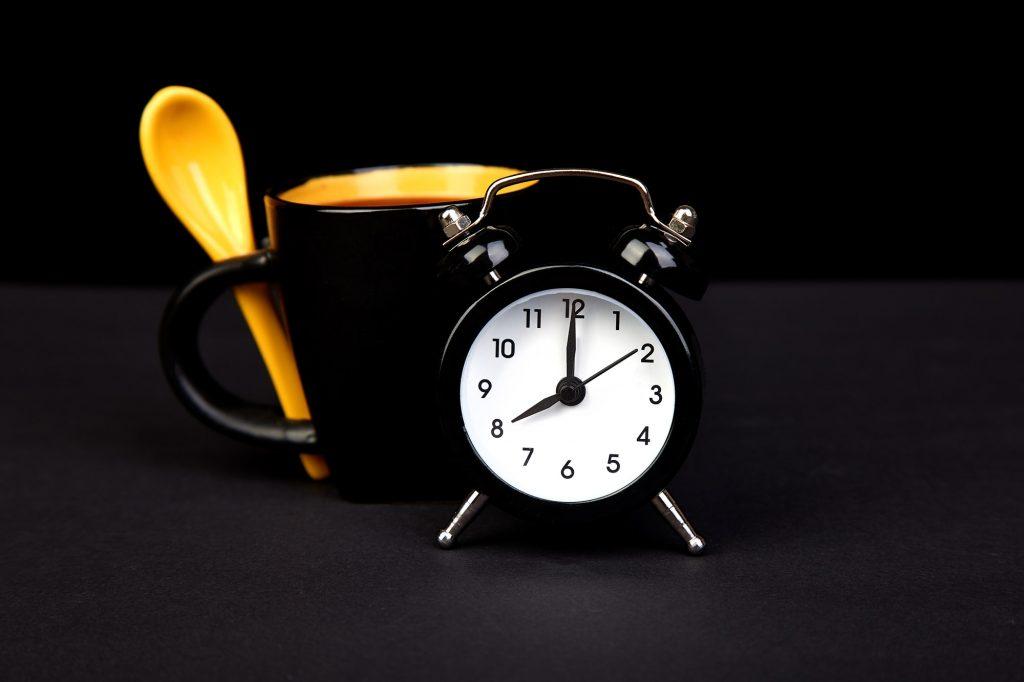 Morning coffee and alarm clock