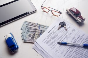 Rent contract with keys and us money on office table